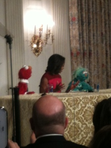 Michelle Obama with Rosita and Elmo