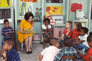 Lady Bird Johnson reads to children in a Project Head Start classroom, March 19, 1966. (National Archives) http://cb100.acf.hhs.gov/childrens-bureau-timeline